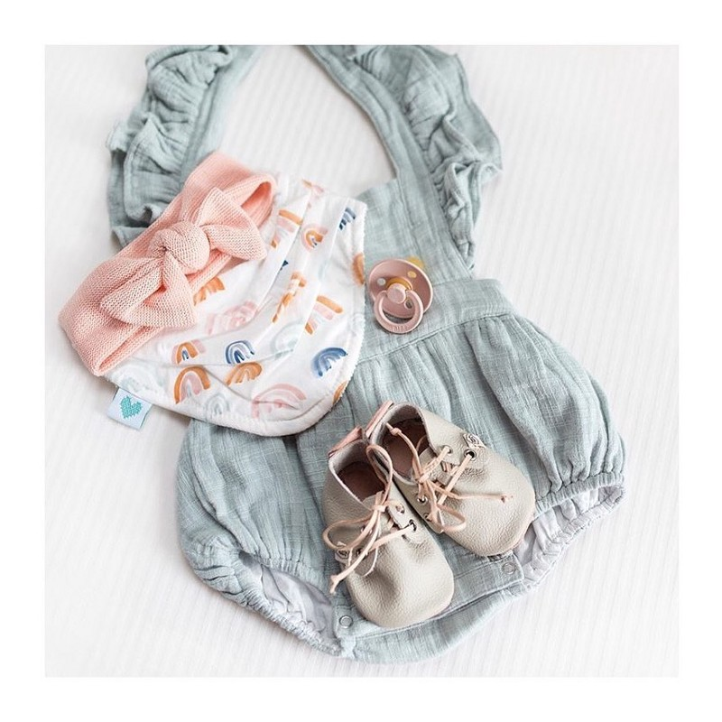 Baby Essentials with romper, bib, dummy, shoes and top knot