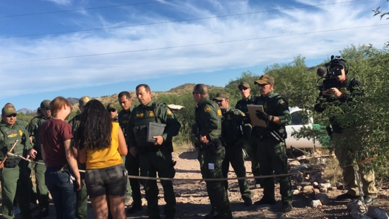 Border agents talk with members of No More Deaths. CREDIT No More Deaths
