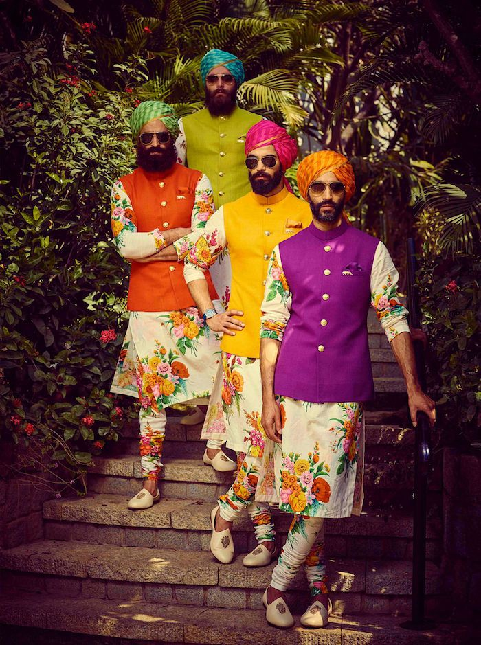 Men wearing floral printed kurtas with bright colored nehru jackets