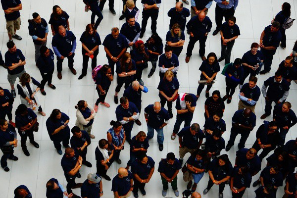 Group of workers standing in a company huddle.