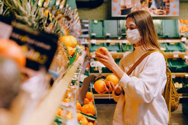 Woman shopping in a store with face mask during Covid-19 emergency