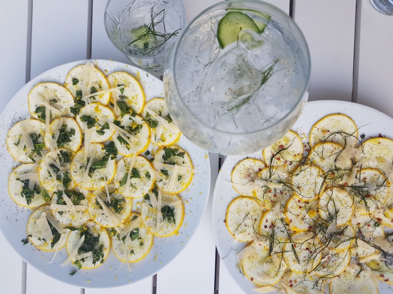 Two plated servings of raw anchovi-squash bites