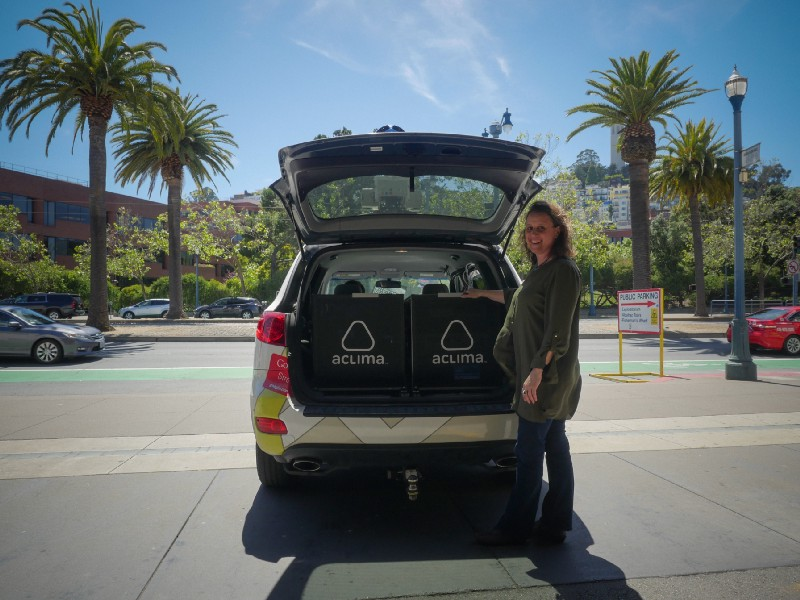 Melissa Lunden, Aclima's Chief Scientist, poses with an Aclima-equipped Street View car.
