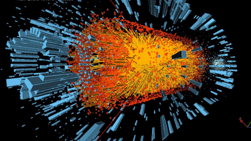 The decay of upsilon particles — another type of meson — into muon pairs as the result of a lead-lead collision. The red lines track the two muons the orange lines track the other particles produced (CERN)