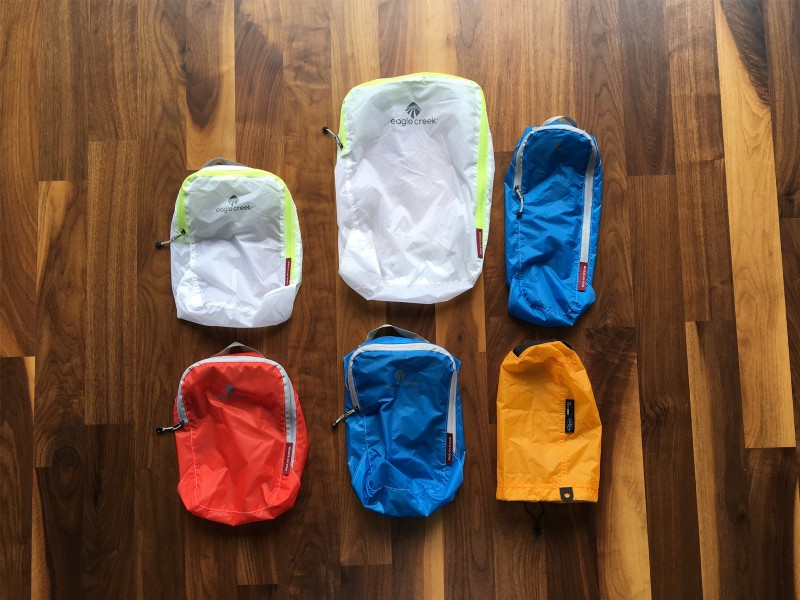 da9c99262865 Eagle Creek Pack-It Specter Cubes  These weigh next to nothing and do a  good job at minor compression and bag organization. Pants and shorts in the  large ...