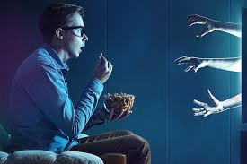 Guy being overwhelmed by hands coming out of the TV