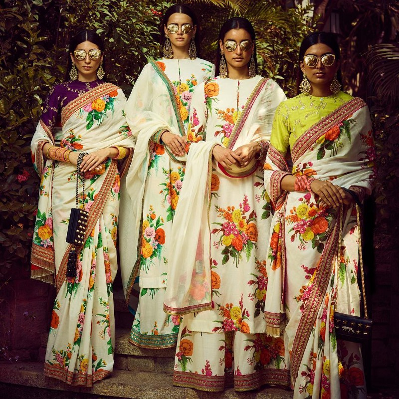 Ladies wearing floral printed sarees from Sabyasachi's collection