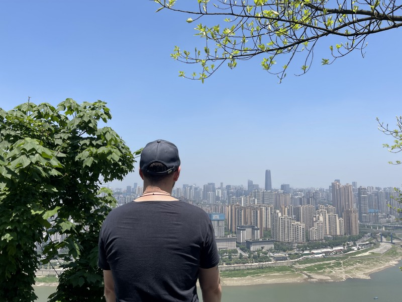 Enjoying the beautiful scenery of downtown Chongqing on the top of Nanshan.