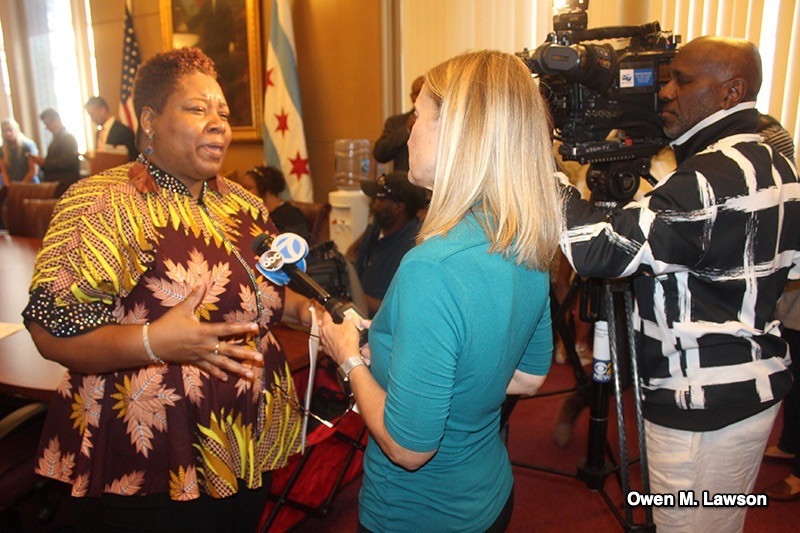 Brand new Ald. Jeanette Taylor (20th) speaks to news media after making an announcement at City Hall. Photo by Owen Lawson