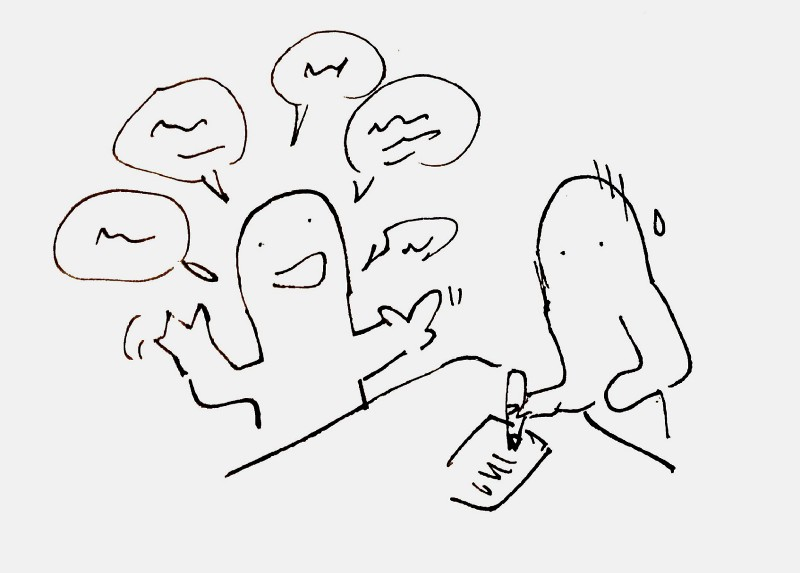 A person talking enthusiastically while another person take notes
