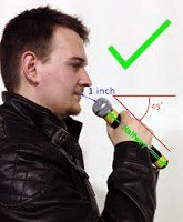 Proper microphone holding and distance from mouth.