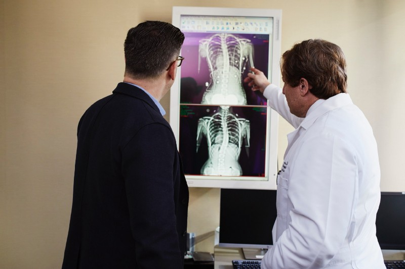 Man with Physician looking at imaging