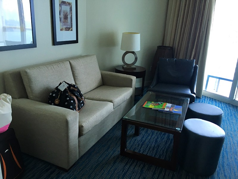 Our luggage, sleeper couch, coffee table, chair, lamp on end table, pictures hung on the wall