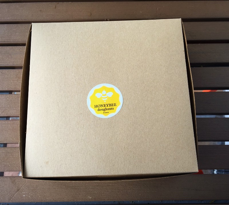 Honeybee Doughnuts sticker on a pastry box