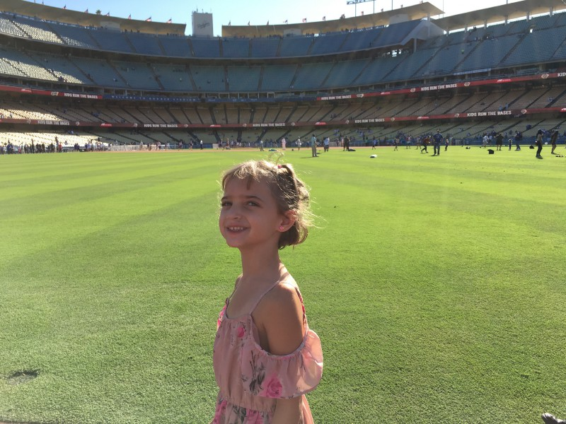 girl in dodger stadium outfield