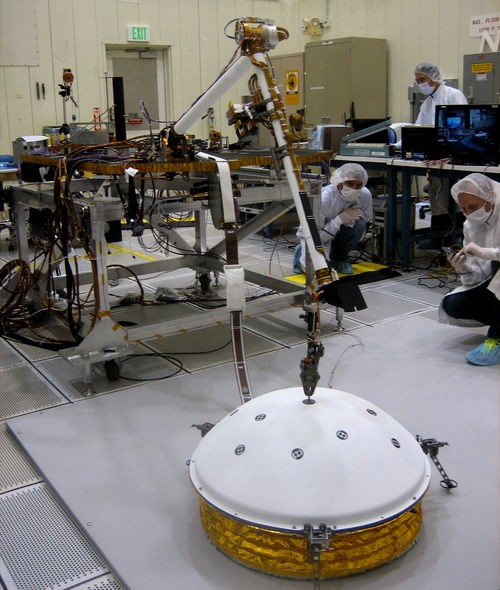 NASA test the deployment of SEIS via InSight's robotic arm.