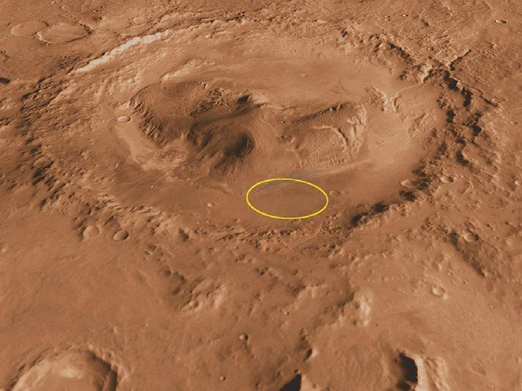 The above image shows Curiosity's landing site in the yellow ring. Mount Sharp is the large central peak (NASA)