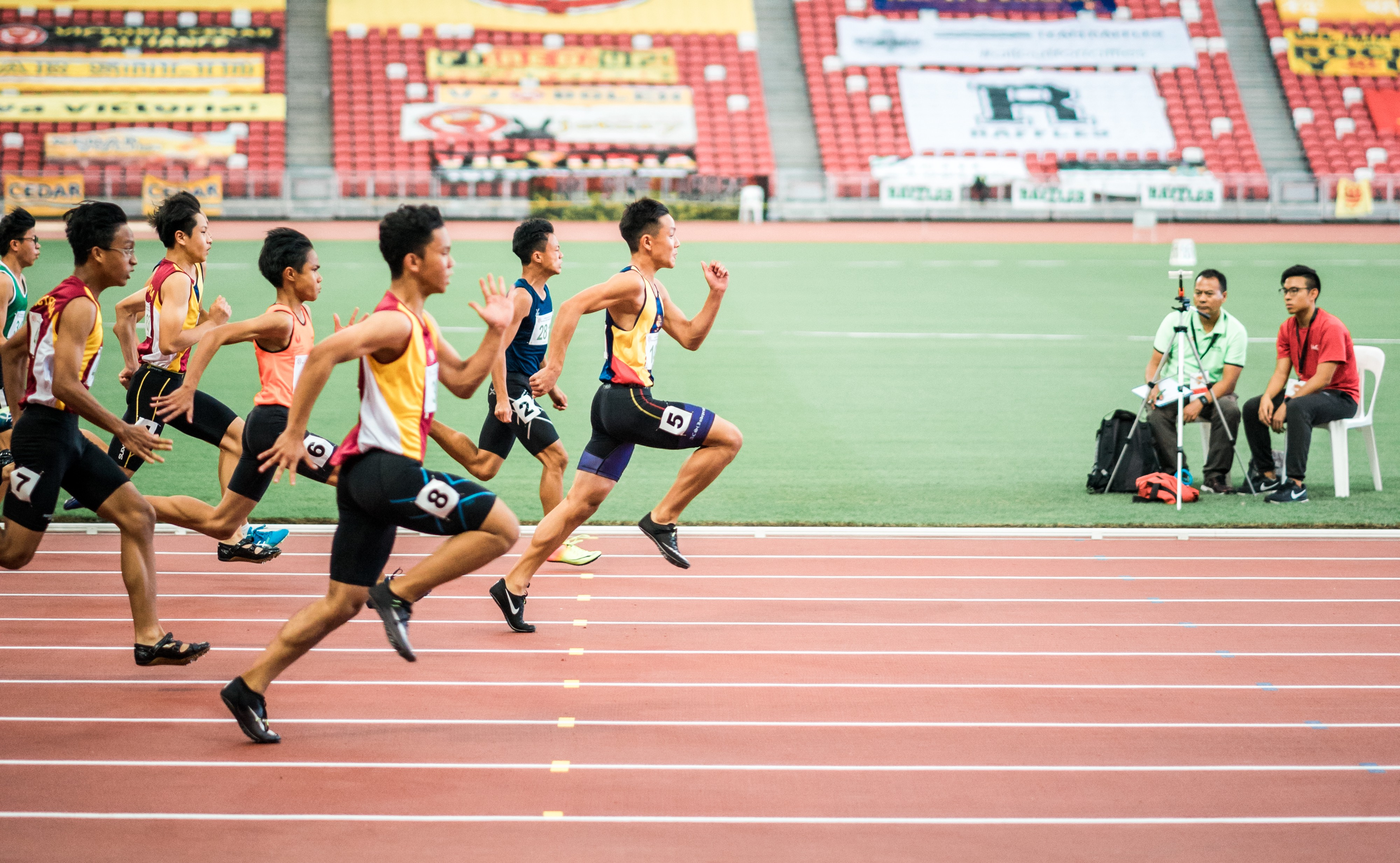 """group of men running in track field"" by Jonathan Chng on Unsplash"