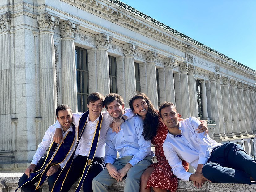 A group of young adults in front of Doe Library