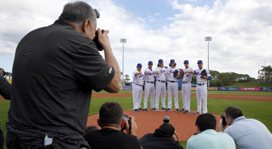 New York Mets pitchers, from right to left, Zach Wheeler, Steven Matz, Jacob deGrom, Noah Syndergaard, Matt Harvey and Bartolo Colon pose for photographers on photo day before a spring training baseball workout Tuesday, March 1, 2016, in Port St. Lucie, Fla. (AP Photo/Jeff Roberson)