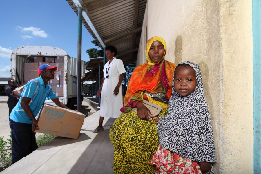 A mother and child wait to be seen at a health clinic in Dar es Salaam, Tanzania. / The Coca-Cola Company