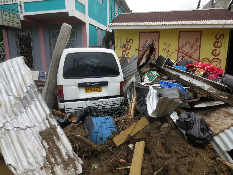 Debris piled in front of a bakery in Dominica's capital city, Roseau, after Hurricane Maria. (USAID)