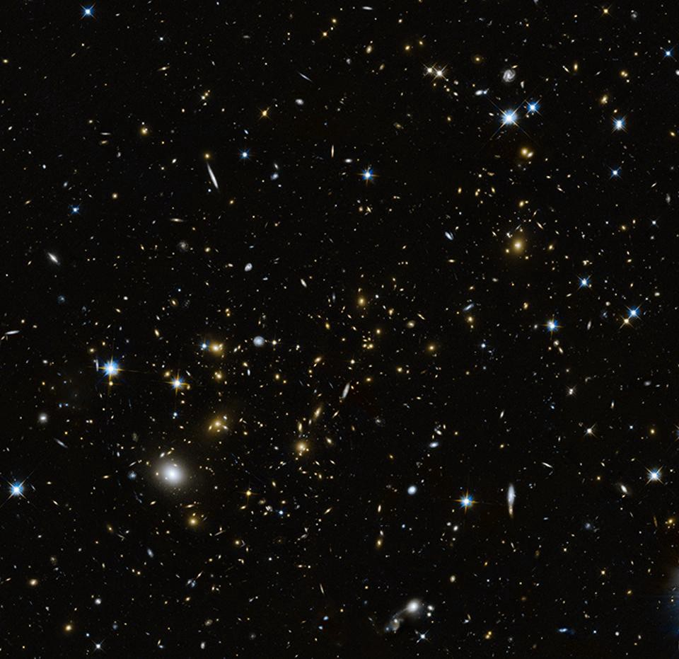 A Hubble Image Of Galaxy Cluster MACS J0717 Which Contains Huge Amount Information About The Itself Thanks To Light From Background